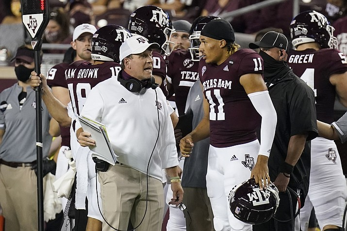 Texas A&M coach Jimbo Fisher, left, talks with quarterback Kellen Mond (11) during the first half of an NCAA college football game against Vanderbilt Saturday, Sept. 26, 2020, in College Station, Texas. (David J. Phillip/AP)