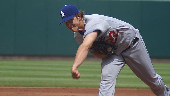 Clayton Kershaw and the Los Angeles advanced to the National League division series by beating wild-card-round opponent the Cincinnati Reds 5-0 on Thursday, Oct. 1. Atlanta and Oakland also advanced Thursday. (Photo by Barbara Moore, cc-by-sa-2.0, https://bit.ly/3fqAezM)