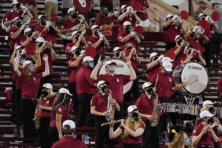 In this Saturday, Sept. 12, 2020 file photo, a reduced size Oklahoma band performs in the stands in the second half of an NCAA college football game against Missouri State in Norman, Okla. Marching bands, part of the game since its beginning more than a century ago, are idled or toned down across the country. (AP Photo/Sue Ogrocki, File)