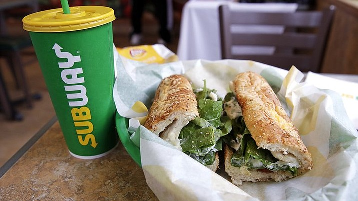 In this file photo, the Subway logo is seen on a soft drink cup next to a sandwich at a restaurant in Londonderry, N.H.. Ireland's Supreme Court has ruled that bread sold by the fast food chain Subway contains so much sugar that it cannot be legally defined as bread. (AP Photo/Charles Krupa, File)