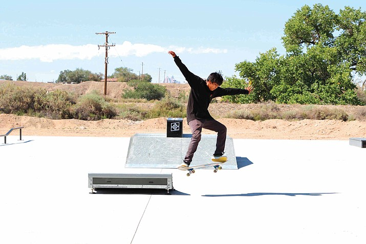 Lemar John does tricks on his skateboard at the new skate park at Nizhoni Park in Shiprock, New Mexico. (Noel Lyn Smith/The Daily Times via AP)