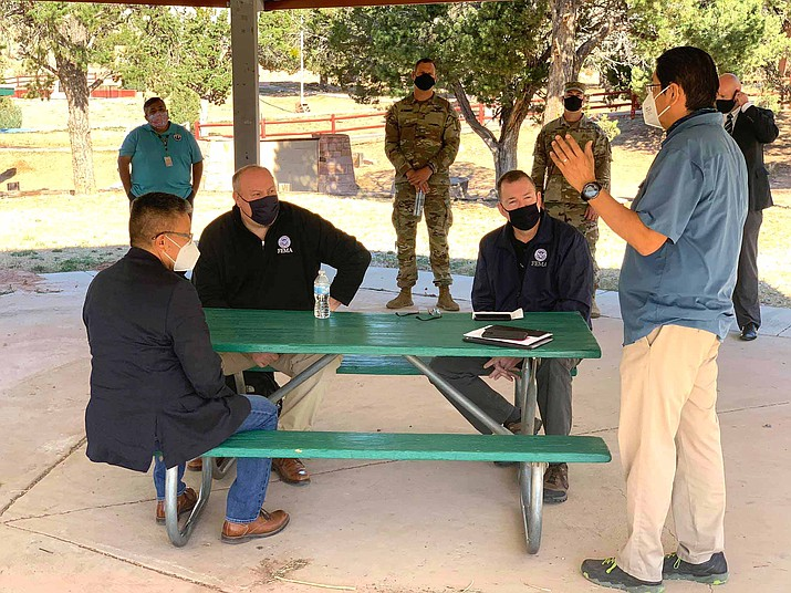 Navajo Nation President Jonathan Nez (right) visits with federal and state officials in Window Rock Oct. 1. (Photo/Office of the Navajo President)