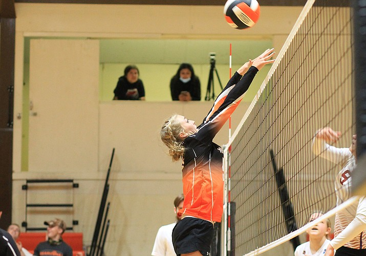Sydnee Mortensen goes for a block in an earlier game with Northland Prep. (Wendy Howell/WGNN)