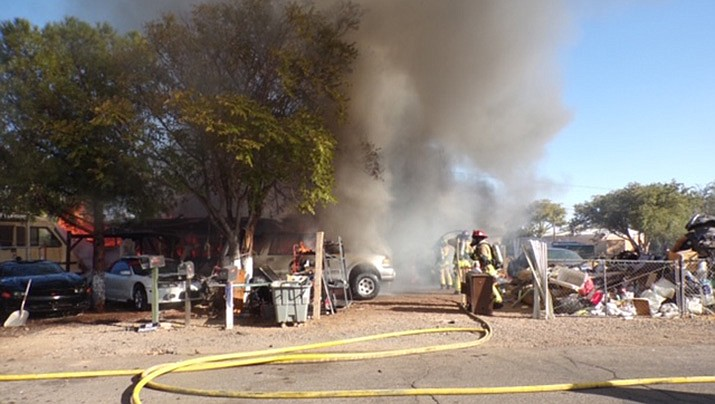 Firefighters from the Kingman Fire Department and the Northern Arizona Consolidated Fire District battle a structure fire in the 3900 block of Ryan Avenue on Tuesday, Oct. 6. (KFD courtesy photo)