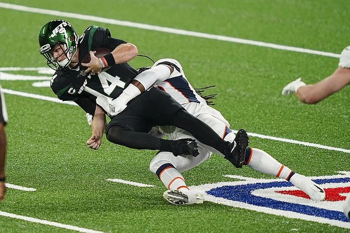 New York Jets quarterback Sam Darnold (14) is sacked by Denver Broncos' A.J. Johnson during the first half of an NFL football game Thursday, Oct. 1, 2020, in East Rutherford, N.J. (John Minchillo/AP)
