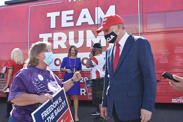 Dewey resident Leigh Cluff speaks with Rep. Andy Biggs in front of the Team Trump tour bus Wednesday morning, Oct. 7, in Prescott Valley. The bus made a stop at the GOP Field Office, 2820 E. Glassford Hill Road, Suite 102. (Photos by Richard Haddad/Courier)