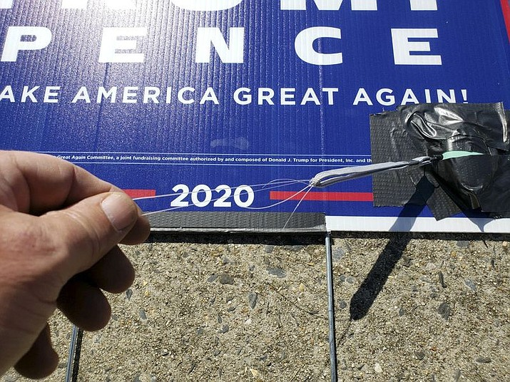 Officials said the devices attached to a Trump/Pence lawn sign in Maryland posed no threat to the public: They're just audible alarms that sound when a pull pin, attached to a string, is tugged away. (Office of the Maryland State Fire Marshal)
