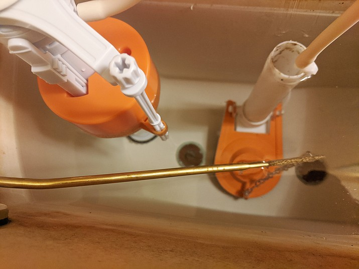 Old toilet parts can cause a headache for its owner. (Sandy Griffis/Courtesy)