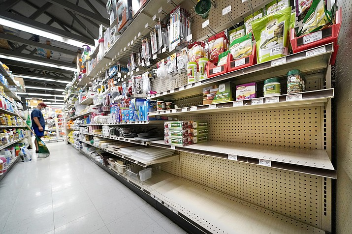 Shelves that are usually stocks with Mason jars and lids in the canning supply section are mostly empty at the Drillin True Value hardware store, Friday, Sept. 4, 2020, in South Portland, Maine. During this ongoing coronavirus pandemic many retailers have been frustrated by the scarce supply of jars and lids used for canning vegetables. (Robert F. Bukaty/AP, file)