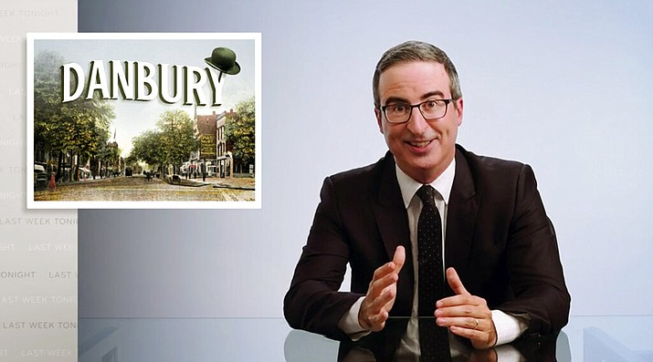 """This video frame grab shows John Oliver from his """"Last Week Tonight with John Oliver"""" program on HBO, Sunday, Aug. 30, 2020. On Aug. 22, Danbury, Conn., Mayor Mark Boughton announced a tongue-in-cheek move posted on his Facebook page to rename Danbury's local sewage treatment plant after Oliver following the comedian's expletive-filled rant about the city. Oliver then offered to donate $55,000 to charity if the city actually followed through with it. On Thursday, Oct. 8, the Danbury City Council voted 18-1 to rename the sewage plant after the comedian. (HBO via AP)"""