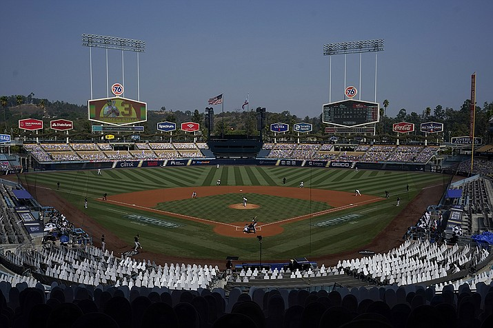 Cutouts are seated at Dodger Stadium as Houston Astros' Zack Greinke, center, pitches against the Oakland Athletics during the first inning of Game 4 of a baseball American League Division Series in Los Angeles, Thursday, Oct. 8, 2020. (Marcio Jose Sanchez/AP)