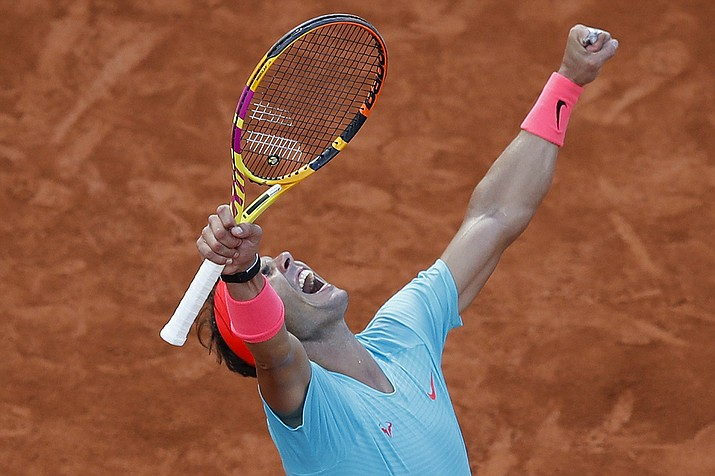Spain's Rafael Nadal celebrates winning the semifinal match of the French Open tennis tournament against Argentina's Diego Schwartzman in three sets, 6-3, 6-3, 7-6, at the Roland Garros stadium in Paris, France, Friday, Oct. 9, 2020. (Alessandra Tarantino/AP)