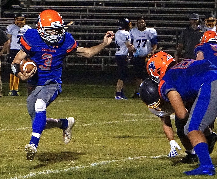 Chino Valley running back Layne Malave (3) runs the ball during a game against Kingman on Friday, Oct. 9, 2020, in Chino Valley. The Cougars won the game 14-8. (Aaron Valdez/Courier)