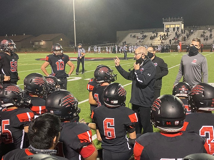 Bradshaw Mountain head coach Bob Young speaks to the team after a 34-31 overtime loss to rival Flagstaff on Friday, Oct. 9, 2020, in Prescott Valley. (Doug Cook/Courier)