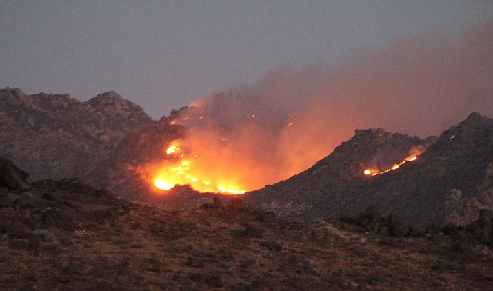 The White Fire had burned about 100 acres in the Cerbat Mountains about eight miles north of Kingman by the morning of Sunday, Oct. 11. (Photo by Casey Jones/Kingman Miner)