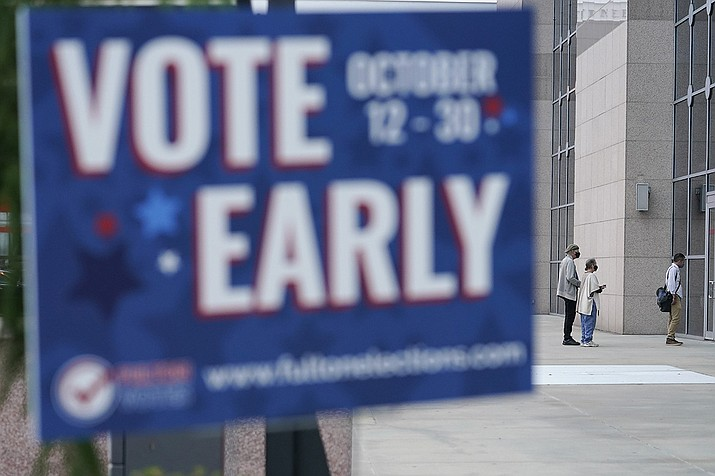 A line forms outside of the State Farm Arena for early voting on Monday, Oct. 12, 2020, in Atlanta. (Brynn Anderson/AP)
