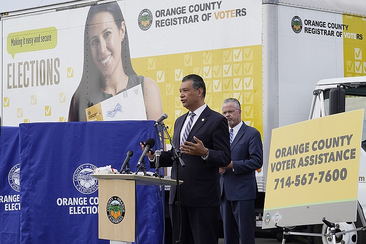 In this Oct. 5, 2020, file photo, California Secretary of State Alex Padilla, left, and Orange County Registrar of Voters Neal Kelley hold a news conference on Orange County's comprehensive plans to safeguard the election and provide transparency in Santa Ana, Calif. California election officials have received reports that unofficial ballot drop boxes were placed in several counties and said these set-ups are illegal. The Orange County Register reports Monday, Oct. 12, 2020, that Secretary of State spokesman Sam Mahood said boxes were reported in Fresno, Los Angeles and Orange counties at locations including political party offices, candidate headquarters and churches. He said the state was looking into the origin of the boxes. (AP Photo/Damian Dovarganes, File)