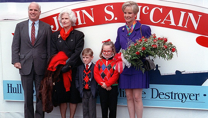 Former U.S. Sen. John McCain, left, poses for a photo with his family at the christening of the guided missile destroyer that carries his name in Bath, Maine, on Sept. 26, 1992. McCain's mother, Roberta McCain, second from left, died Monday, Oct. 12 at age 108. (Official U.S. Navy photo/Public domain)