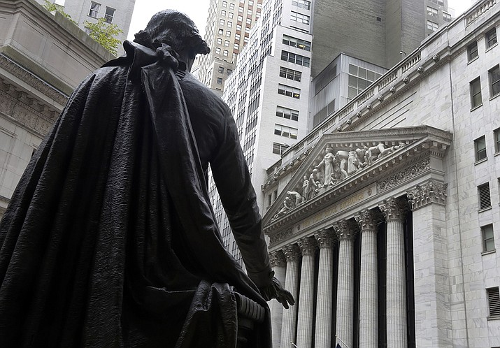 In this Oct. 2, 2014, file photo, a statue of President George Washington on the steps of Federal Hall faces the facade of the New York Stock Exchange. Wall Street is pushing higher on Monday, Oct. 12, 2020, and tacking more gains onto last week's rally, its best in more than three months. (Photo/Richard Drew, AP File)
