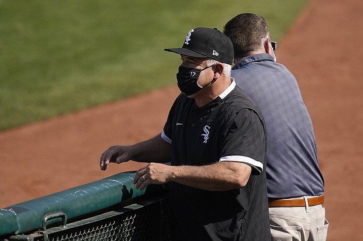 Chicago White Sox manager Rick Renteria watches as players practice during a baseball workout in Oakland, Calif., Monday, Sept. 28, 2020. The Chicago White Sox and Renteria have agreed to split following a disappointing finish to a breakout season in which the team made the playoffs for the first time in 12 years. (Jeff Chiu/AP)