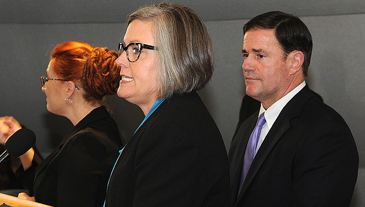 Arizona Secretary of State Katie Hobbs, center, has asked an appeals court, should it rule against extending Arizona's voter registration deadline, to allow several days to let voters complete their registration. (Photo by Howard Fischer/For the Miner)