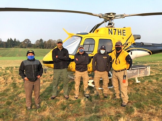 Navajo Helitack crewmembers include, from left: Lidiana Soto (Santa Fe Helitack), Benson Johnson, crew member, Dan  Begay, manager, Forrest Towne, crew member and Ronald Jumbo, squad boss. (Photo/BIA Wildland Fire Management - Navajo Region)