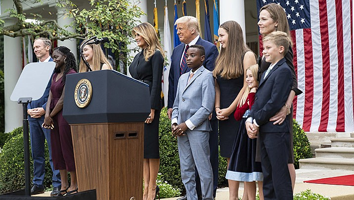 Judge Amy Coney Barrett, second from right, stands with her family, President Donald Trump and First Lady Melania Trump at a ceremony announcing Barrett's nomination for a seat on the U.S. Supreme Court. Barrett, at a Senate hearing on Tuesday, Oct. 13, would not commit to recusing herself from disputes stemming from the upcoming election. (Official White House photo/Public domain)