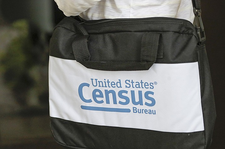 A briefcase of a census taker is seen as she knocks on the door of a residence Tuesday, Aug. 11, 2020, in Winter Park, Fla. A half-million census takers head out en mass this week to knock on the doors of households that haven't yet responded to the 2020 census. (John Raoux/AP)