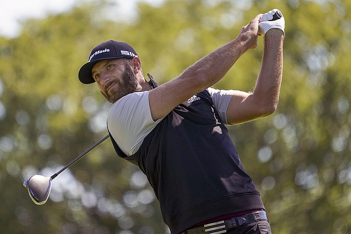 In this Saturday, Sept. 19, 2020, file photo, Dustin Johnson hits from the fourth tee during the third round of the U.S. Open Golf Championship, in Mamaroneck, N.Y. Dustin Johnson withdrew from the CJ Cup at Shadow Creek on Tuesday, Oct. 13, 2020, because of the coronavirus, the most prominent player since golf resumed in June to test positive. The PGA Tour said in a statement that Johnson notified officials he was experiencing COVID-19 symptoms and was given another test that came back positive. (John Minchillo, AP File)