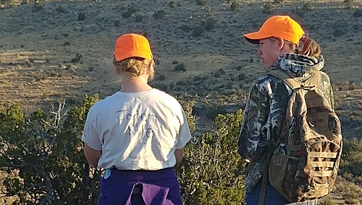 Kingman residents and sisters Jaden Kile, left, and Kaitlin Kile, are shown during an elk hunt in Arizona game management unit 10. Jaden harvested a young elk during the hunt. (Photo by Don Martin/For the Miner)