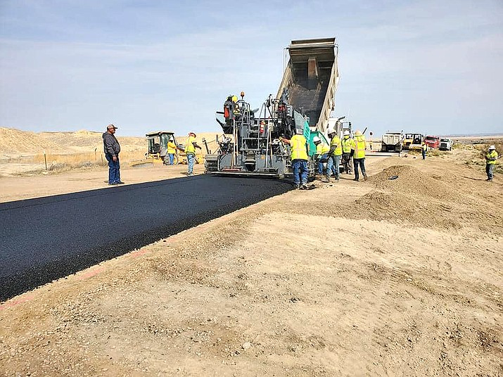 An 8 inch aggregate base is laid on Navajo Route 57 along with 3 inches of asphalt to repair road damage. The project was completed Oct. 2. (Photo/Office of the Navajo President)
