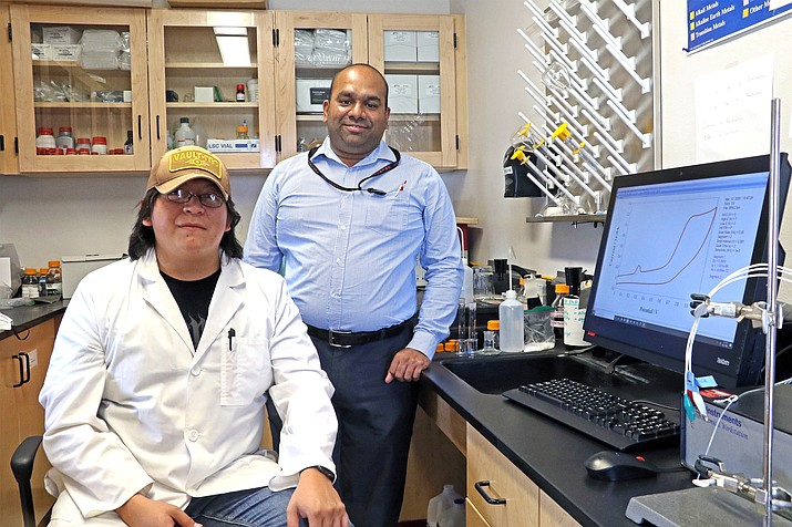 Robinson Tom and Dr. Thiagarajan Soundappan continue their research on energy storage systems in NTU's wet labs in Crownpoint, New Mexico. (Photo/Navajo Technical University)