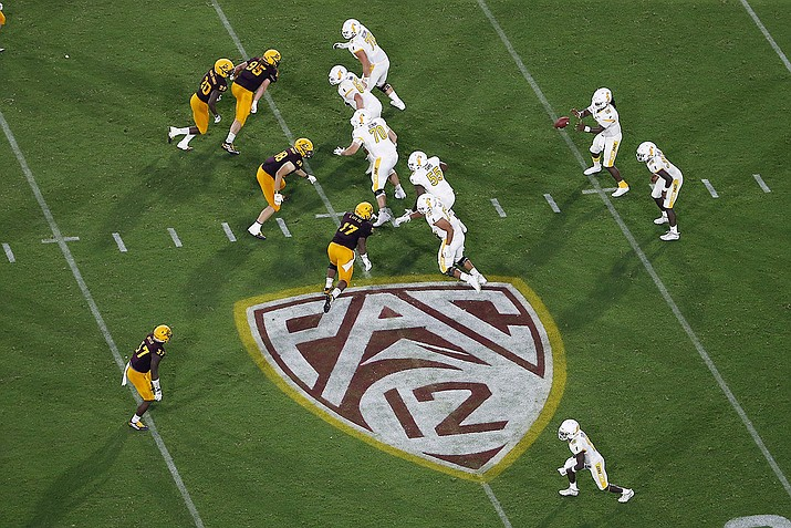 In this Aug. 29, 2019, file photo, is the Pac-12 logo during the second half of an NCAA college football game between Arizona State and Kent State, in Tempe, Ariz. The return of football isn't likely to make much of a dent in the losses athletic departments across the Pac-12 will ultimately incur because of the coronavirus pandemic. Faced with dramatic budget shortfalls, most schools in the league have already resorted to layoffs, furloughs, and cutting some sports entirely. ( Ralph Freso, AP File)