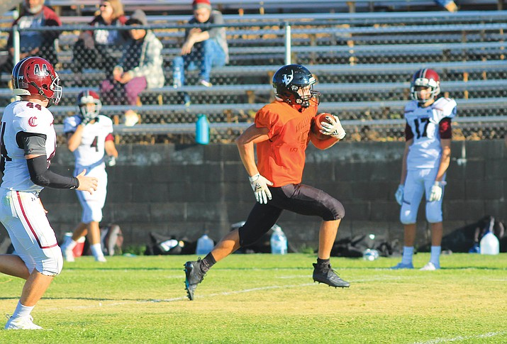 Viking Drew Logan runs the ball for some yards during an early season scrimmage. (Wendy Howell/WGCN)