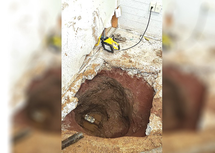 A water pipe is exposed at Williams City Hall following a water leak that damaged parts of the building. (Submitted photo)
