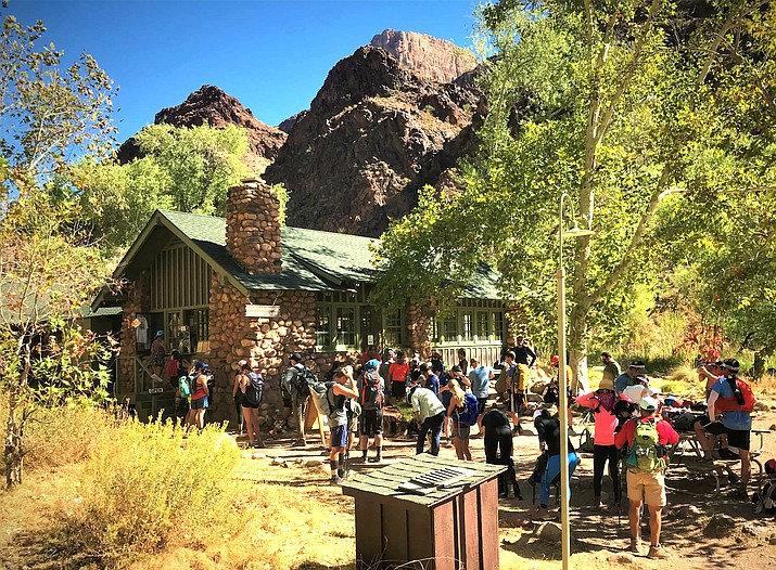 A group of North Rim to South Rim hikers and runners convene outside the Phantom Ranch Canteen at the bottom of Grand Canyon. (NPS Photo/K. McHugh)