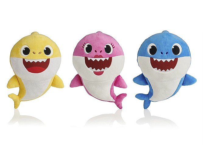"""This picture shows the WowWee pinkfong Baby Shark family of singing plush toys. Two former Oklahoma jail employees and their supervisor face misdemeanor cruelty charges after investigators found they forced inmates to stand handcuffed for hours and listen to the children's song """"Baby Shark"""" on repeat. (AP Photo/WowWee)"""