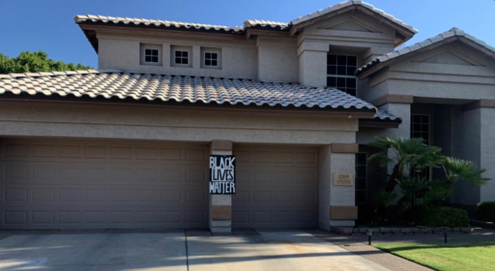 Melanie Boyle of north Glendale received a violation notice from her homeowners association that said her Black Lives Matter sign had to be taken down. (Photo by Luke Simmons/Cronkite News)