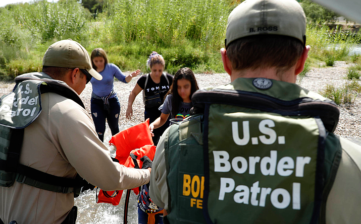 Border Patrol agents intercept immigrants near Eagle Pass, Texas, in this photo from August 2019 – the end of one of the busiest years for border apprehensions, with more than 977,000. Since then, apprehensions have fallen by half, a drop many experts to impacts from COVID-19. (Photo by Jaime Rodriguez Sr./U.S. Customs and Border Protection)