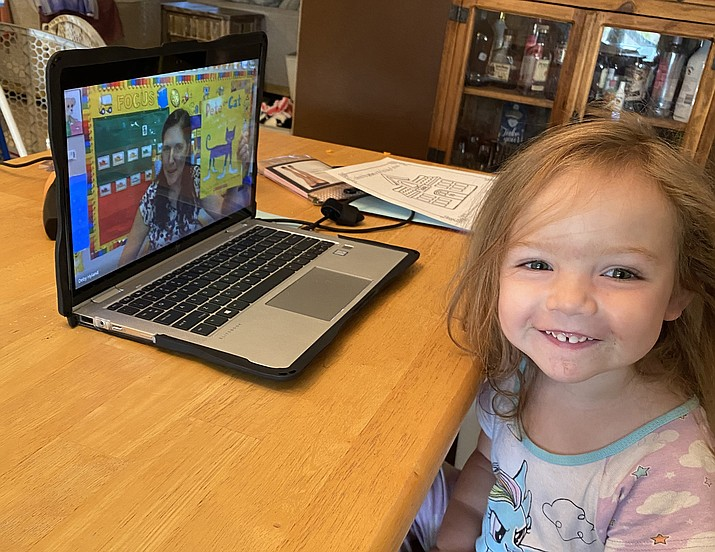 Three-year-old Haisley Holder, a student at Territorial Early Childhood Center in Chino Valley, sits in front of her laptop at home during the first day of school on Monday, Aug. 10, 2020. Chino Valley Unified School District opted to open the school year with at-home, online-only instruction due to concerns surrounding the coronavirus pandemic. At a special meeting on Tuesday, Oct. 13, the Chino Valley School Unified School District Governing Board voted to approve the return of full in-person instruction, beginning on Monday, Oct. 26. The decision drew an onslaught of mixed reactions from parents, teachers and staff members. (Erika Holder/Courtesy, file)