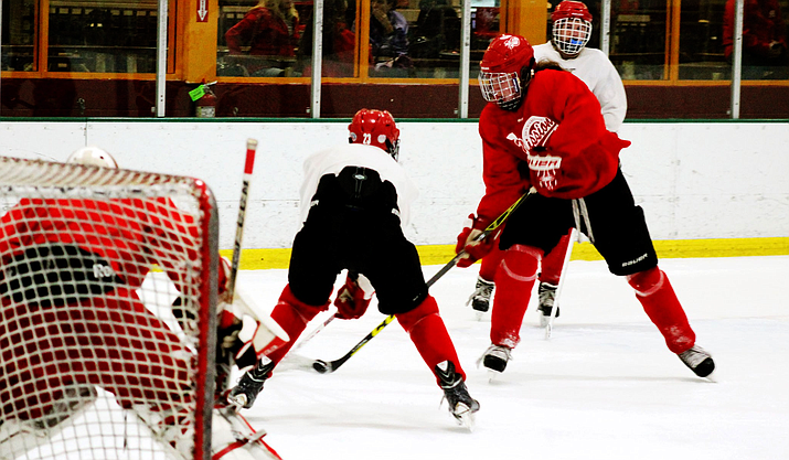 Participation in youth sports, particularly hockey, can be costly. (File photo by Cori Crenshaw/Cronkite News)