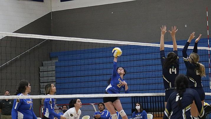 Kingman High School senior Esther Torres returns a shot against Yuma Catholic on Tuesday, Oct. 13. Kingman lost 3-0. (Photo by Travis Rains/Kingman Miner)