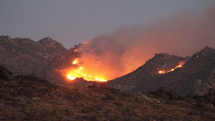 The White Fire north of Kingman is now 80% contained and is no longer growing, fire managers reported on Wednesday, Oct. 14. (Miner file photo)