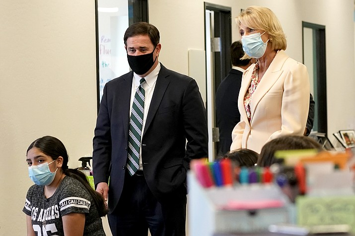 Gov. Doug Ducey and U.S. Secretary of Education Betsy DeVos observe a classroom setting Thursday, Oct. 15, 2020, at the Phoenix International Academy in Phoenix. (Matt York/AP)