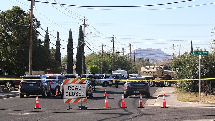Kingman Police Department officers block Fairgrounds Boulevard at Gates Avenue during a standoff with a suspect who was later found deceased. (Photo by Travis Rains/Kingman Miner)