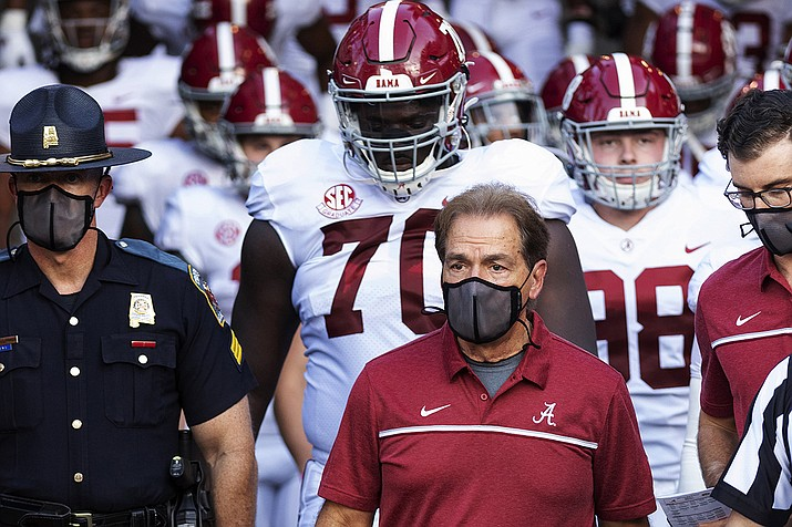 In this Sept. 26, 2020, file photo, Alabama coach Nick Saban leads his team to the field before an NCAA college football game against Missouri in Columbia, Mo. Saban and athletic director Greg Byrne have tested positive for COVID-19, four days before the Southeastern Conference's biggest regular-season showdown. The second-ranked Crimson Tide is set to face No. 3 Georgia on Saturday, and may be without their iconic 68-year-old coach. (L.G. Patterson, AP File)