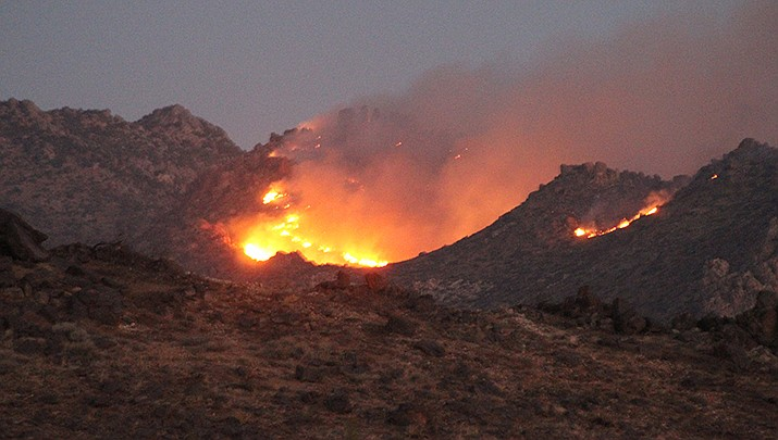 Smoke from wildfires that have scorched large parts of the West Coast this year are being linked to emergency room visits and deaths of the elderly and infirm. A wildfire in the Cerbat Mountains near Kingman this month is shown above. (Miner file photo)