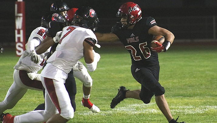 James Garcia of Lee Williams High School stiff arms a Coconino defender during the Volunteers' 28-21 loss to the Panthers on Oct. 9. Lee Williams (1-1) plays at Bradshaw Mountain on Friday, Oct. 16. (Photo by Travis Rains/Kingman Miner)