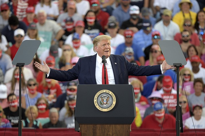 President Donald Trump addresses supporters during a campaign rally at the Ocala International Airport, Friday, Oct. 16, 2020, in Ocala, Fla. The Trump campaign has scheduled a visit to the Prescott Airport for Monday, Oct. 19. (Phelan M. Ebenhack/AP)