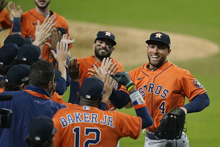 Houston Astros George Springer (4) and Jose Altuve celebrate with teammates after winning Game 6 of a baseball American League Championship Series against the Houston Astros, Friday, Oct. 16, 2020, in San Diego. The Astros defeated the Rays 7-4 to tie the series 3-3. (Gregory Bull/AP)